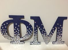 Phi Mu wooden sorority letters in navy blue and ombre rhinestones