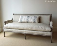 Antique sofa recovered in linen with down filled cushion