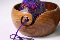 Handmade Wooden Yarn Bowls. Great idea. They also have specialty yarns and other items on their website: darngoodyarn.com
