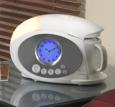coffee maker and an alarm clock all in one compact bedside design