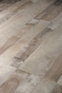 Inessence by Provenza is reminiscent of recycled wood, stone and cement. (ceramicheprovenza.com)