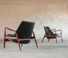 Pair of 'Seal' chairs by Ib Kofod-Larsen | From a unique collection of antique and modern lounge chairs at http://www.1stdibs.com/furniture/seating/lounge-chairs/