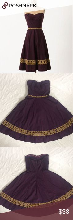 Girls From Savoy Aubergine Dress Adorable full skirt strapless dress. Aubergine (eggplant) colored with goldfish yellow embroidered design. It zippers down the back and has elastic in the back which allows flexible sizing. True to size. Measurements: 34in long, waist is 13in and bust is about 14in but very flexible since the back is elastic. Anthropologie Dresses Strapless