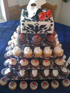 Phantom of the Opera Wedding by klassy kakes, via Flickr I like this idea of one cake to save, and then cupcakes for everyone else!