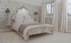 Create a fairy tale scheme with the palest oyster pinks, soft grey blues and a silver princess style bed. This type of scheme is a tasteful, elegant version of what every little girl dreams of having! Syliva silver luxury bed from The French Bedroom Company.