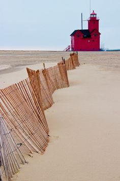 The Lighthouse Big Red in Holland Michigan - getting ready for winter with the snow fence!  The locals laugh at this.
