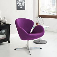 It is elegantly designed, made to add a luxurious modern style to any office, reception area or living room.  https://www.barcelona-designs.com/products/swan-chair-in-wool #homedecor #furnituresale #midcentury #interiordesign