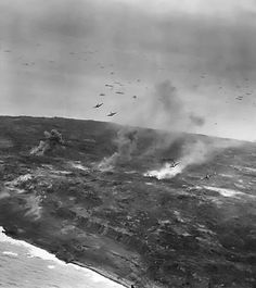 A group of F6F Hellcat fighters supporting ground troops on Iwo Jima, 21 Feb 1945