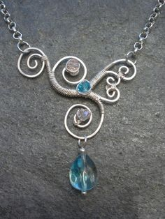 This pendant is wire wrapped in nontarnishing silver wire.