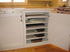 Divided shelves help to keep everything easy to access and store to make your kitchen organised and functional