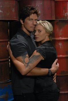 Starbuck & Anders of Battlestar Galactica -- love how the tattoos come together.