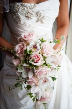 Shower trailing bouquet of pale pink roses and Orchids at Northbrook Park by Fiona Curry Flowers
