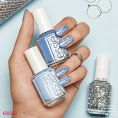 Glam up your holiday mani with winter blues and silver sparkles. Get this holiday essie nail art design using 'pret-a-surfer' an immersive marine blue, 'bikini so teeny' a sparkling, cornflower blue' and 'set in stones' a disco mirror ball glitter.