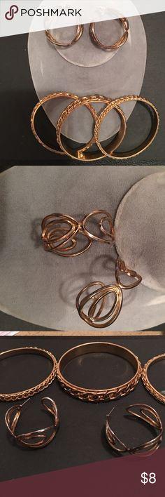 Gold toned bangle bracelets and earrings 3 pretty gold toned bangle bracelets with gold and silver toned earrings Jewelry Bracelets