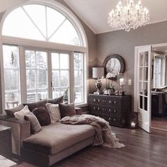 Beautiful window, flooring, lighting, and colors. Nice choice of furniture. Looks inviting. Very attractive.