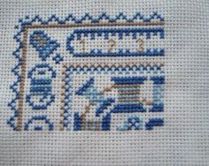Part 1 in cross stitch.