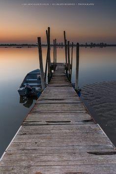 Fishing Village by Ricardo Bahuto Felix..... #sky #sunrise #lake #sea #sunset #water #boat #beach #travel #blue #sun #light #bridge #summer #beautiful #horizon #green #wood #fishing #village #lisbon #portugal