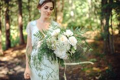 whimsical white bouquet of roses, fern and queen anne's lace