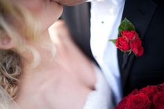 Southern weddings - red roses boutonniere