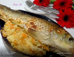 Вкуснейшаая рыба с гарниром, так сказать «два в одном». Карп получается нежнейшим, а рис рассыпчатым и очень вкусным, оторваться невозможно. Карпа берем примерно 1,5 — 2 кг. Рис 2/3 стакана.