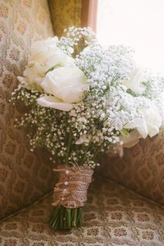 Lovely white roses and baby's breath look charming wrapped in burlap. Shop roses and baby's breath year-round at GrowersBox.com!