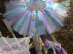 Winter Wonderland Tutu Set with Matching Hair Bow / Frozen Birthday Outfit / Photoshoot Outfit / Sparkly Tutu with Snowflakes by abitofglamour on Etsy https://www.etsy.com/listing/215241607/winter-wonderland-tutu-set-with-matching