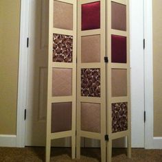 DIY- Take out glass panels in room devider and Cover styrofoam with fabric for the squares.