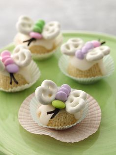"""You'll be amazed by how fast these treats will fly off your table this Easter! Homemade cupcakes get turned on their heads and decorated with yogurt-covered pretzel """"wings"""" and other colorful candies to make each treat look like a beautiful butterfly."""