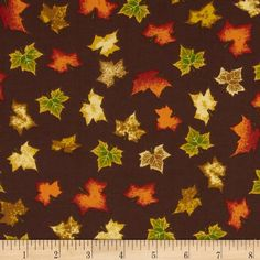 Harvest Bounty Tossed Leaves Chocolate from @fabricdotcom  This fabric is perfect for quilting, apparel and home decor accents. Colors include orange, green, gold and brown.