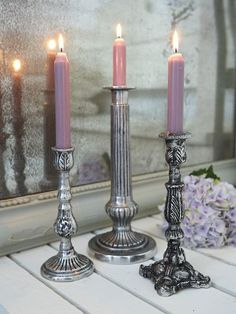 Reminiscent of days gone by, these aged metal candle holders will add a retro feel to any table.