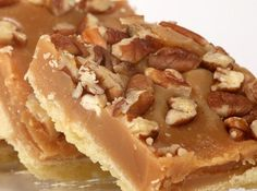 A classic shortbread crust recipe topped with a chewy layer of toffee and crunchy pecans. Millionaire Toffee Pecan Bars Recipe from Grandmothers Kitchen. Cake Bars, Dessert Bars, Pecan Bars, Toffee Bars, Pecan Praline Cake, Saltine Toffee, Caramel Bars, Pecan Pralines, Candy Recipes