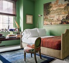 The master bedroom, painted in a custom-blended Benjamin Moore green, is graced by a 19th-century French wallpaper panel; behind the bespoke Avery Boardman daybed hangs a circa-1940 William Malherbe portrait of Eberstadt's mother, Mary. Interior design by John Yunis and architect Pietro Cicognani.
