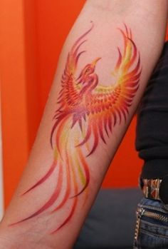 Beautiful colours on this stylized phoenix  Maris Pavlo - gallery - Hammersmith Tattoo