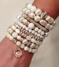 Pearls, mother of pearl and silver. Great for the bride. Follow Lisa Jill Jewelry on Facebook .