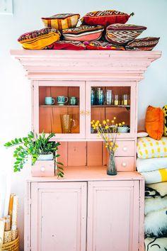 adorable pink hutch & colorful pillows / justina blakeney via design*sponge.