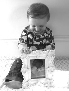 picture of one year old with her infant pic