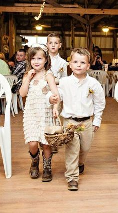 Adorable flower girl and ring bearer at a country wedding: http://www.countryoutfitter.com/style/real-country-wedding-sydney-warren/
