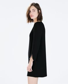 DRESS WITH ARM SLITS