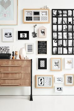 black and white and wood. gallery wall.