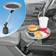 Invest in a swivel tray for all your fine-dining needs. | 21 Insanely Clever Tricks To Vastly Improve Your Car