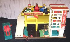 This garage with the ramp, the cars, and the working elevator was a magnificent toy.