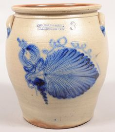 """Sold $ 3,750 Cowden & Wilcox, Harrisburg, PA Fern Leaf Decorated 3 Gallon Stoneware Crock. Circa. 1860-1887. Bold cobalt blue slip large fern leaf, tulip, bell flower and spiraling vine decoration. Ovoid form with flared rim and ear handles. Ex Clyde Youtz Collection. 12 3/4"""" high. Condition: Very good."""