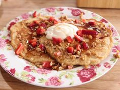 Get this all-star, easy-to-follow Strawberry Granola Pancakes recipe from Ree Drummond