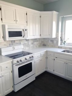 black stainless kitchenaid appliances white cabinets home