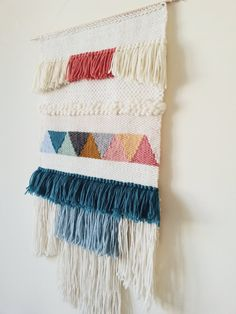 Handwoven wall hanging made with all natural fibers and using a variety of weaving techniques. Each piece is unique, carefully handwoven one