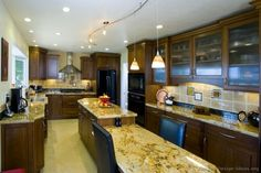 kitchens with dark cabinets light island - Google Search