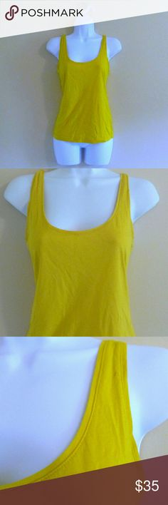 "(298) Kate Spade Goldenrod Tank - Size M Great basic tank by fine label Kate Spade Saturday. Small flaw in one strap, pictured. Beautiful goldenrod color. Lightweight, flattering, and well-made. A great addition to your designer closet. Bust: 33"", waist: 33"", length: 23.5"", label: Kate Spade Saturday, size: M, materials: Cotton. kate spade Tops Tank Tops"