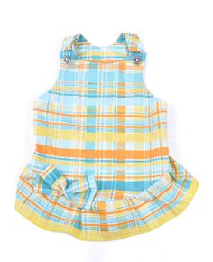 This Jess & Co canine/dog dress is made from a lightweight cotton fabric perfect for those hot summer days. The dress features traditional overall buckles and a pretty bow on the back all in the bright plaid design.   Shop Online - Kaylo Luxury Pet Boutique