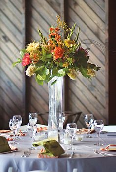 Large centerpieces featured roses, calla lilies, and daisies. Photo: Justin & Mary Marantz.