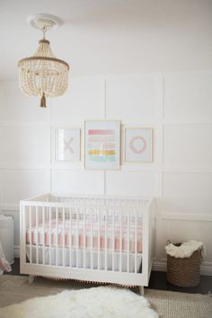 Bright White & Pastel Baby Girl Nursery Reveal white nursery modern nursery light pink nursery wood bead chandelier